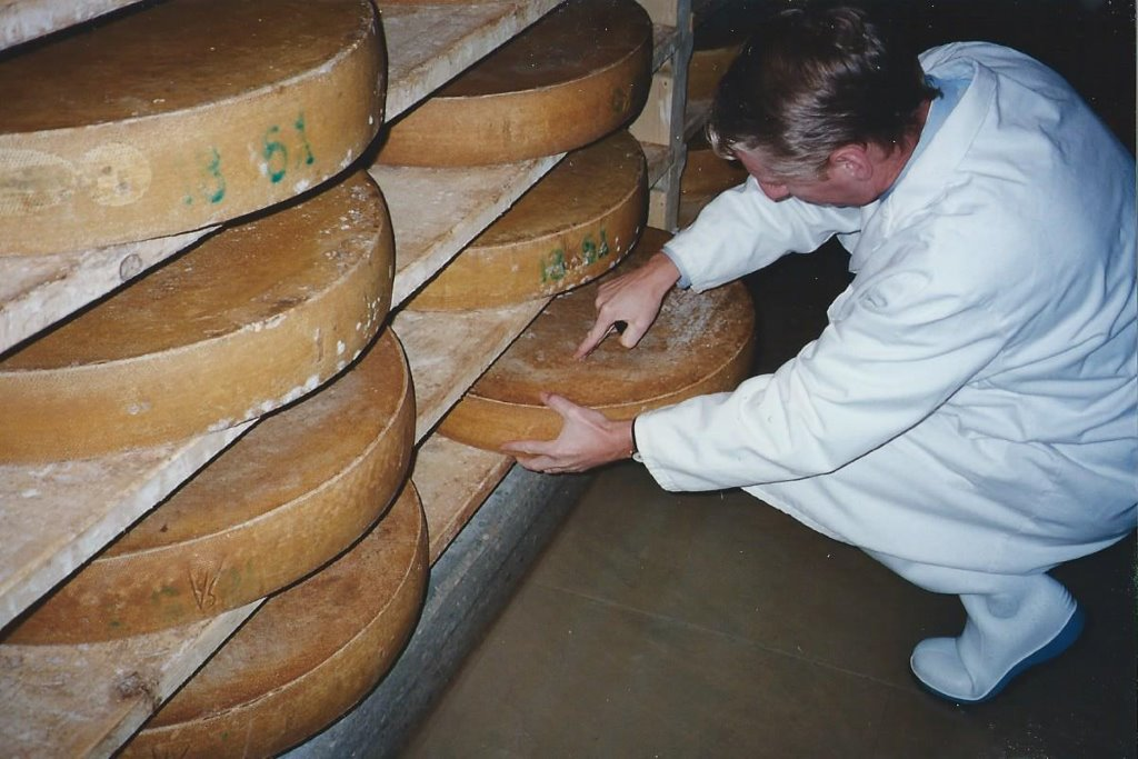 Pictured are wheels of Comte aging, an example of affinage.
